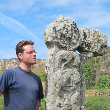 Thomas Small beside the Pictish cross at A'Chill on the Isle of Canna.
